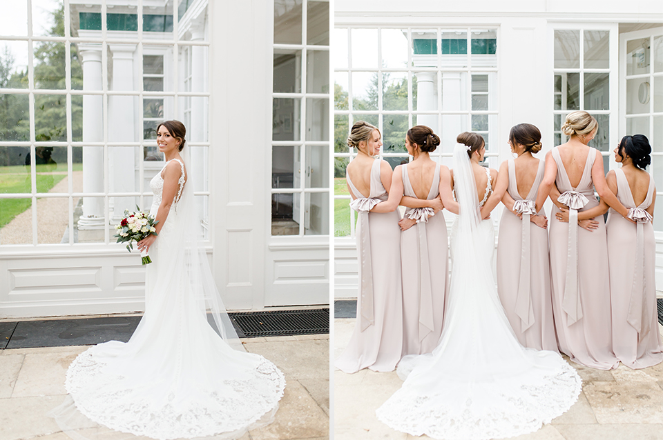 The bride wore a stunning lace gown and her bridesmaids wore nude pink dresses at Clock Barn in Hampshire