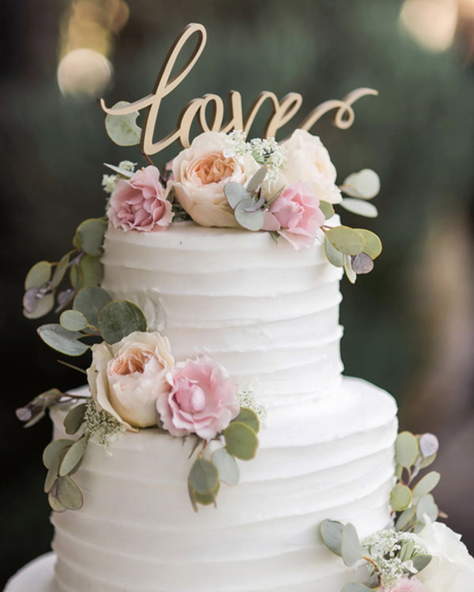 A Romantic Wedding Message On A Cake Topper Adds The