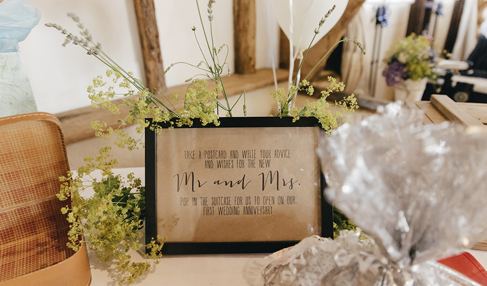 Display romantic requests for your guests in pretty frames on decorated tables at your Clock Barn wedding