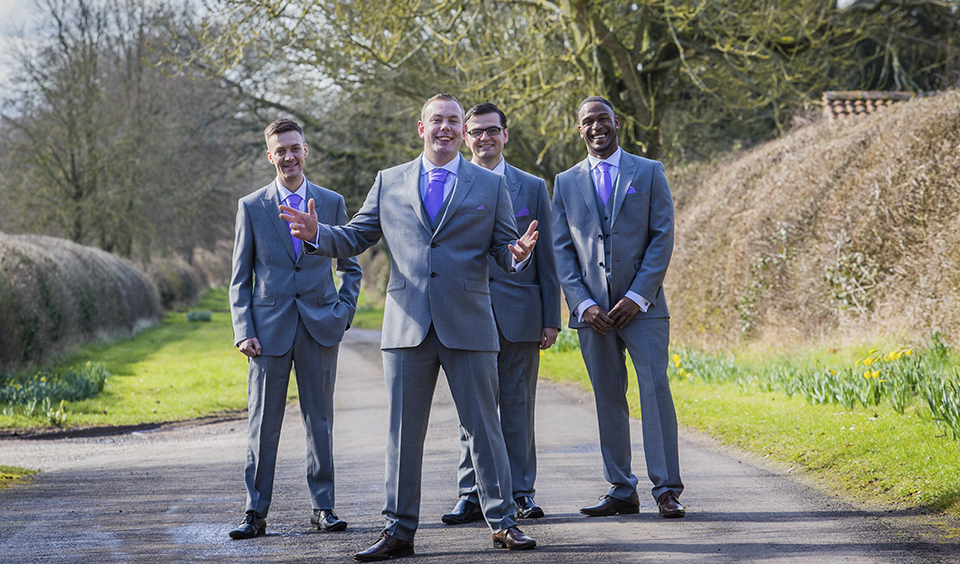 The groom and groomsmen wore grey suits and lilac coloured ties at this barn wedding in Hampshire