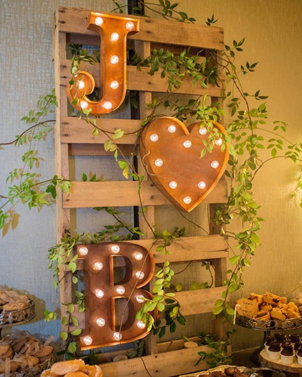 A display of light up letters spelling out romantic words or your and your partner's initials is perfect for a barn wedding at Clock Barn