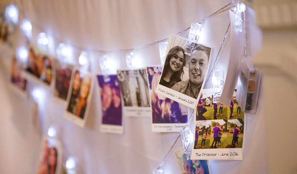The gift table was decorated with cute polaroids of the wedding couple at Clock Barn in Hampshire