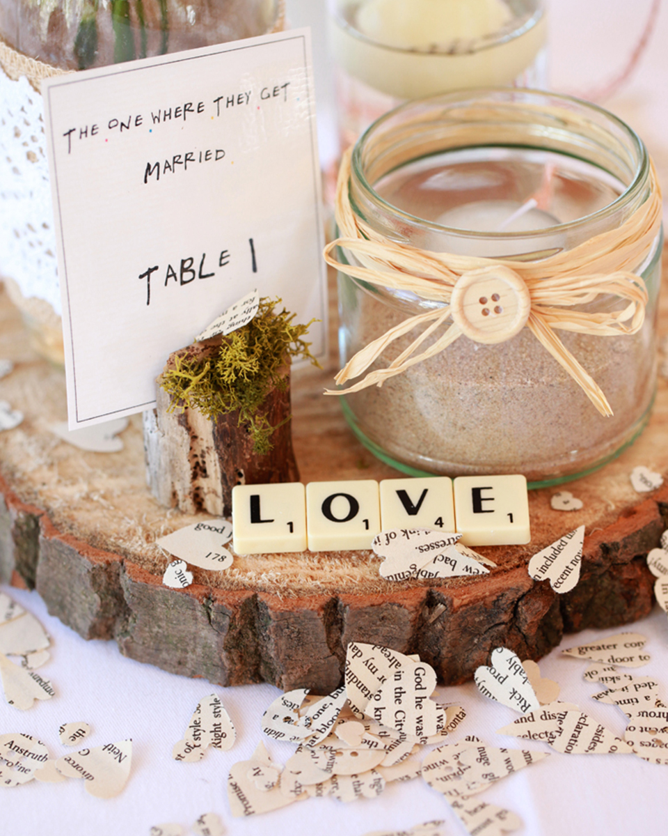 Decorate your tables with heart shaped confetti and scrabble love letters for a romantic touch to your wedding décor at Clock Barn in Hampshire