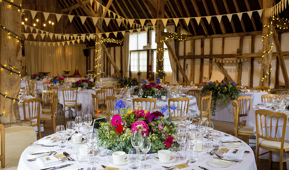 Decorate your wedding table with arrangements of beautifully bold coloured flowers at your Clock Barn wedding