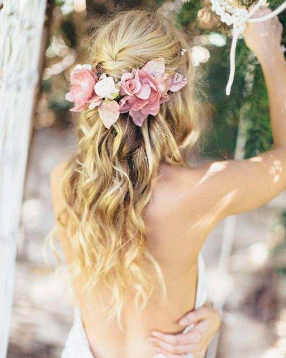 Keep hair styles soft and unstructured adding floral hair decorations for that wonderfully romantic look for your barn wedding in Hampshire