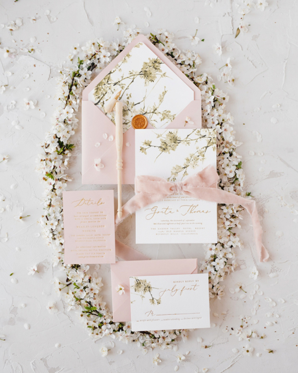 Romantic designs on your wedding invites give hints of your special day at Clock Barn