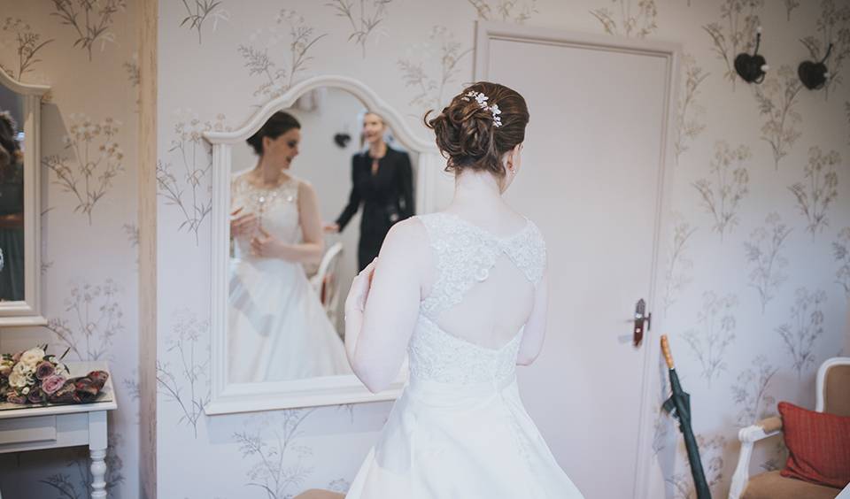 The bride prepares for the day ahead in the bridal preparation room at Clock Barn in Hampshire