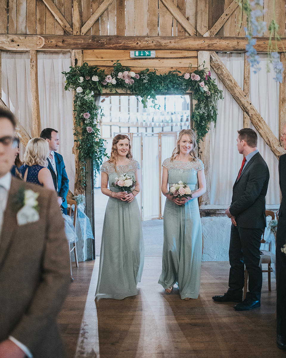 The bridesmaids wore pretty sage green dresses at this rustic barn wedding In Hampshire