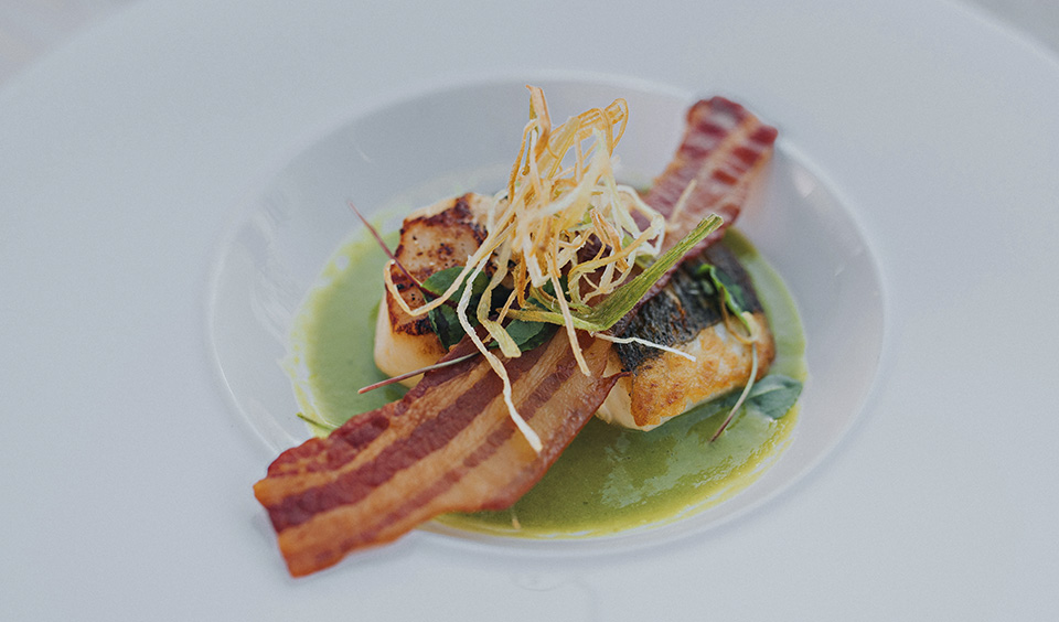 Impress your guests with a delicious scallop starter at your barn wedding at Clock Barn in Hampshire
