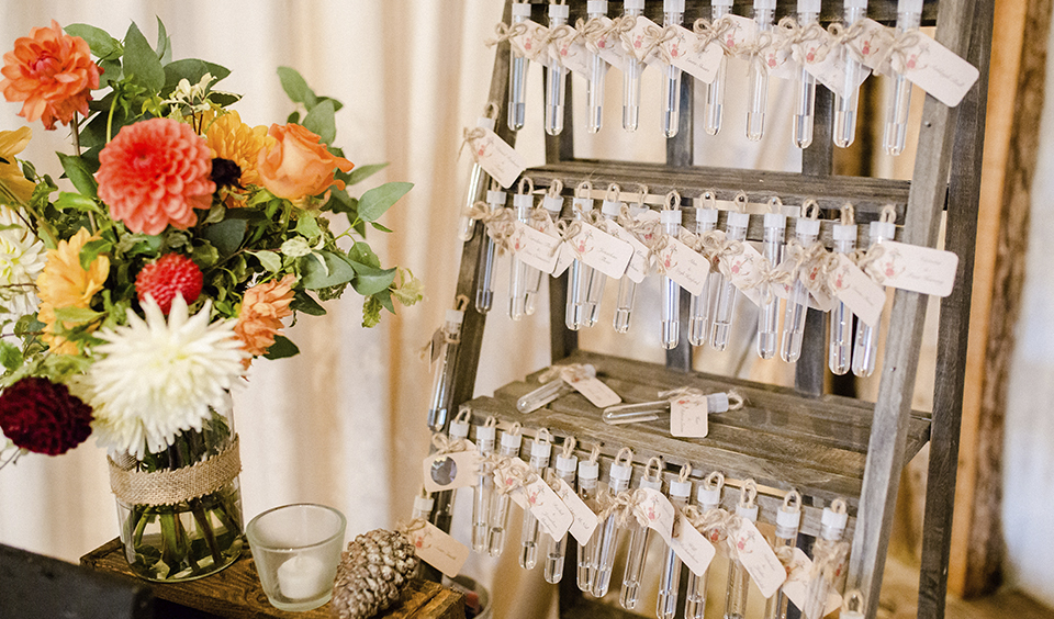 This unusual wedding seating plan was made from labelled test tubes displayed on a wooden frame at this Clock Barn wedding