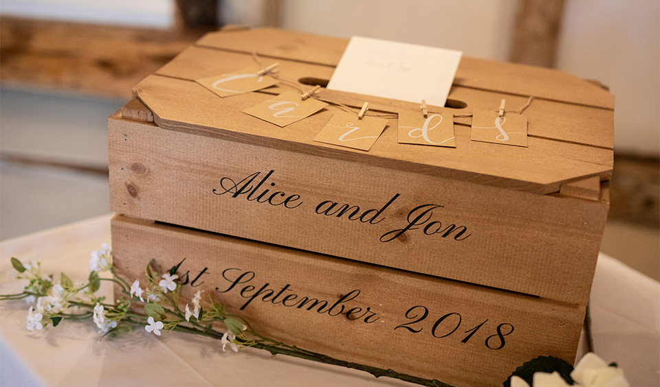 The wedding couple chose a handmade personalised wooden card box for their autumn wedding at Clock Barn