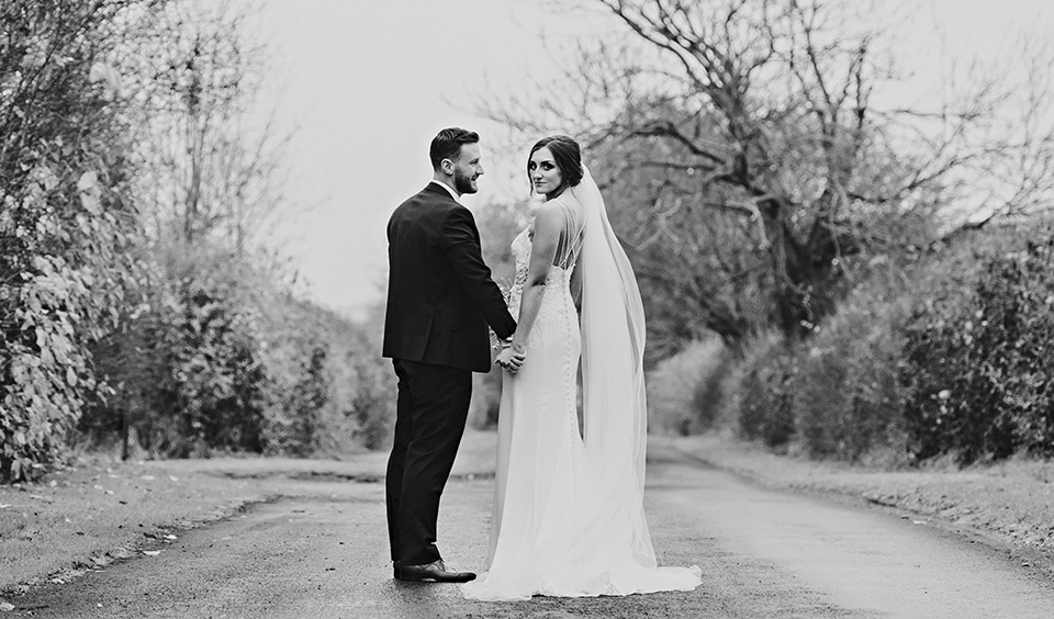The newly married couple pose for some beautiful wedding photos at this rural wedding venue in Hampshire