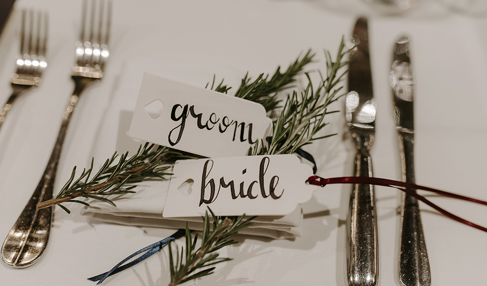 The place names were hand-written and displayed with elegant sprigs of rosemary at this barn wedding in Hampshire