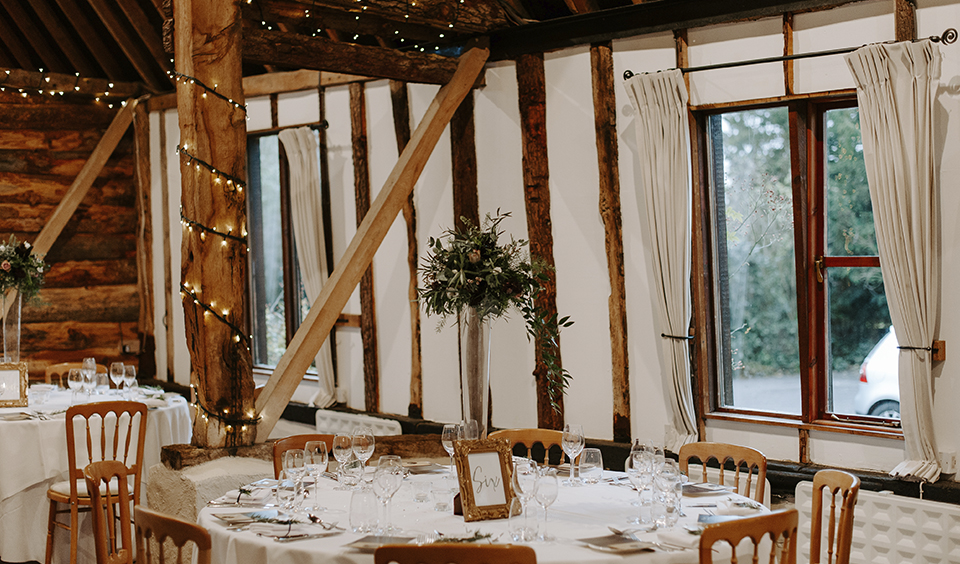 The table numbers were displayed in rustic wooden frames at this barn wedding at Clock Barn in Hampshire