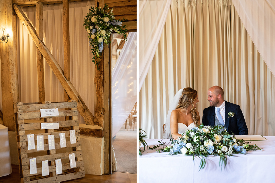 The table plan was displayed on a rustic wooden pallet and a beautiful arrangement of summer flowers decorated the ceremony table at Clock Barn