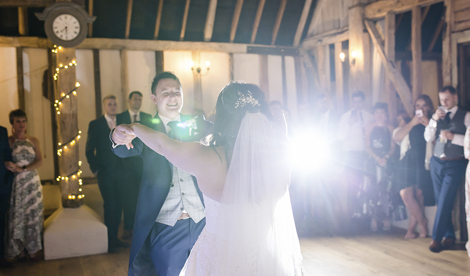 The happy couple take the dance floor for their first dance at their wedding evening at Clock Barn