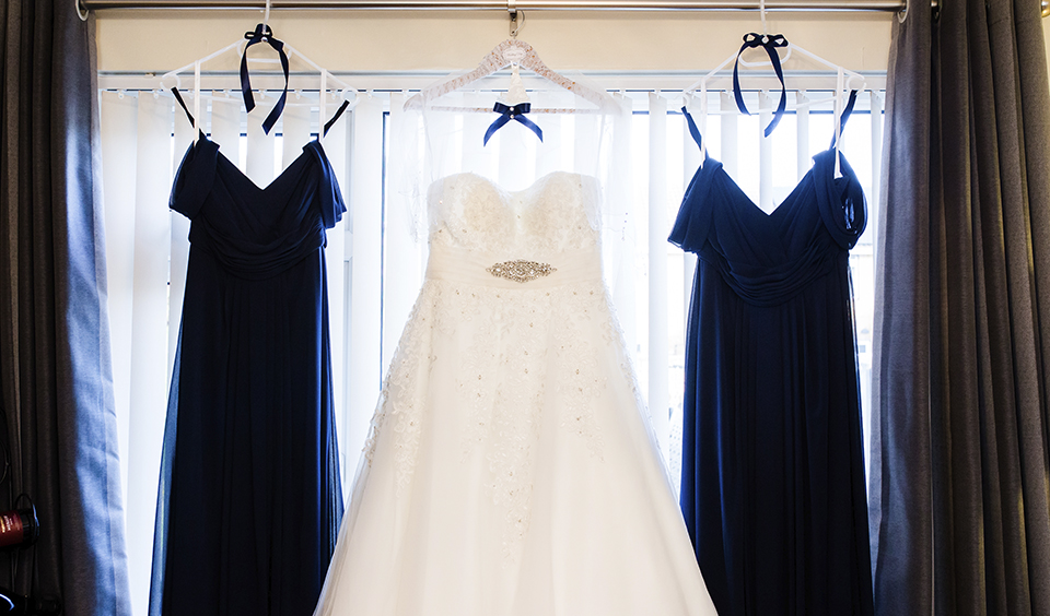 The brides dress and bridesmaid dresses are ready to be worn at this barn wedding in Hampshire