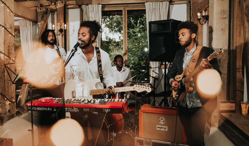 A reggae band play at the wedding reception at Clock Barn in Hampshire